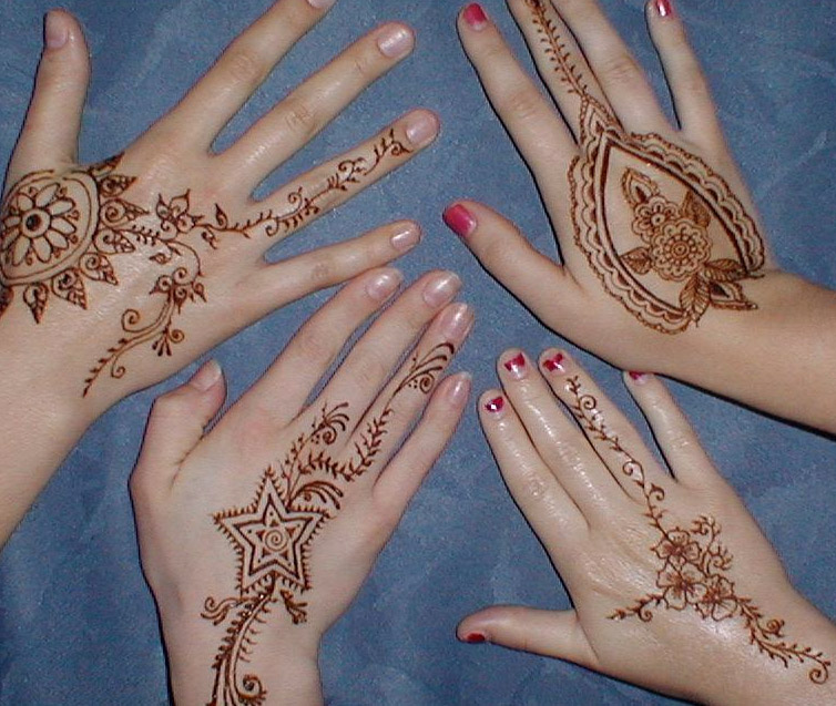 Feminine Henna Hand Tattoo Designs