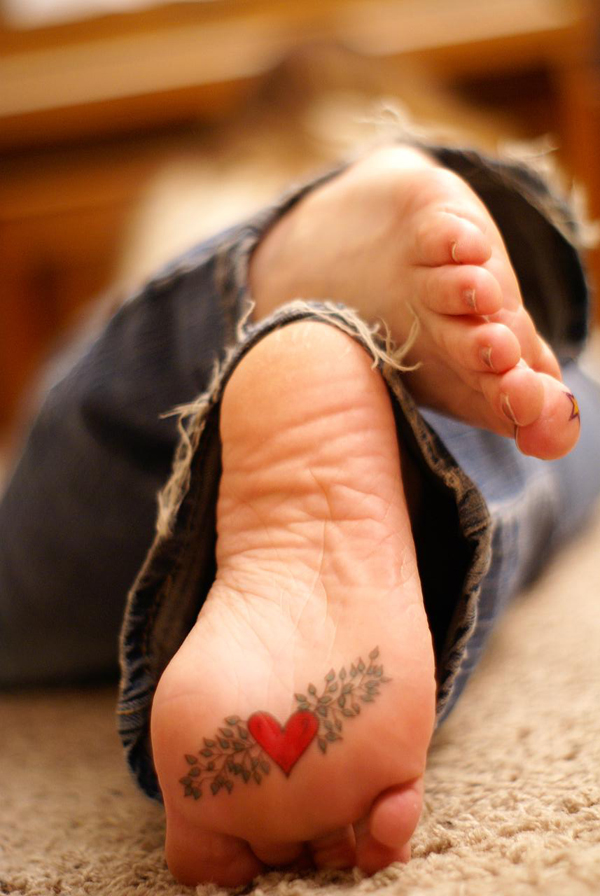 Heart under foot Tattoo