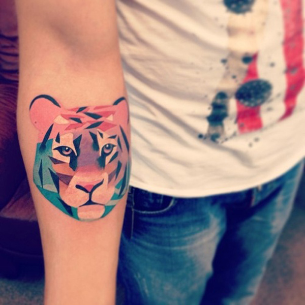 Watercolor tiger tattoo on arm