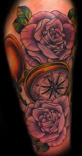 Compass tattoo with red roses