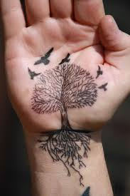 tree tattoo with birds