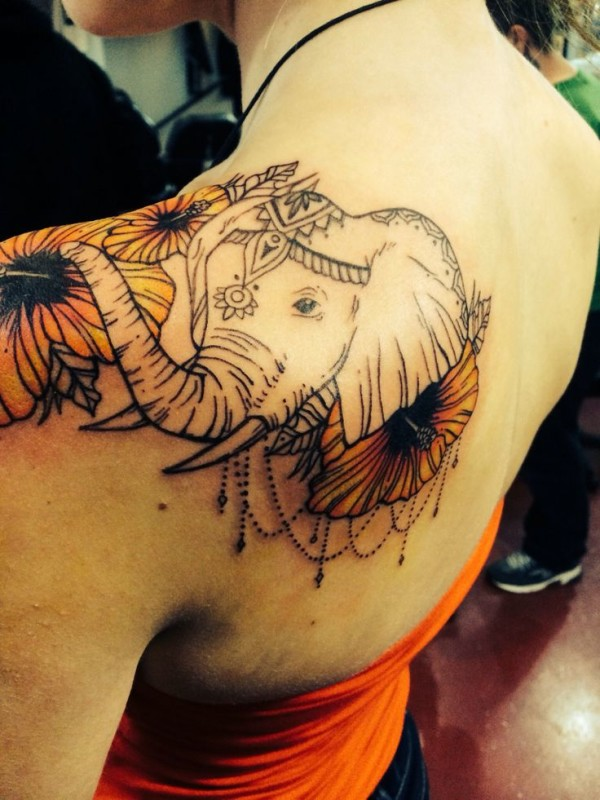 Elephant tattoo on upper back
