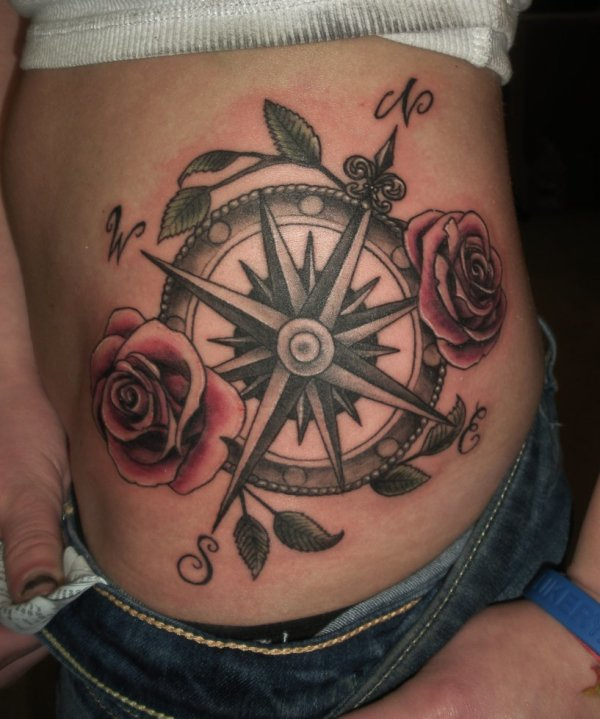 Compass tattoo on side
