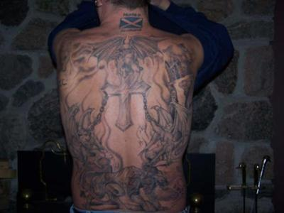 Full back religious tattoo