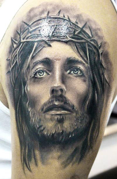 Jesus tattoo on hand