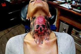 Skull tattoo on neck