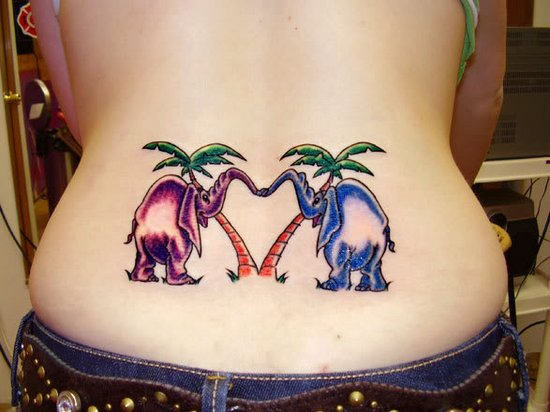 Elephant tattoo on lower back