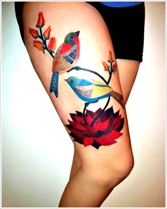 Bird tattoo on thigh