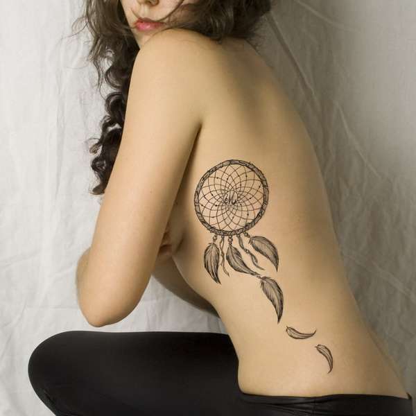Dreamcatcher tattoo on side