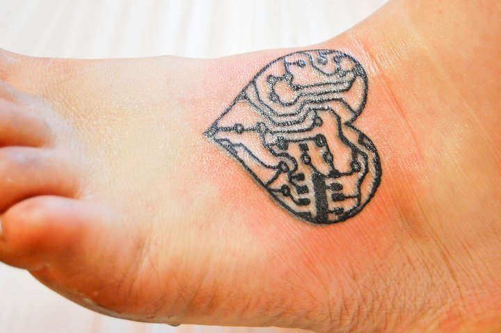 Circuitry heart tattoo on foot