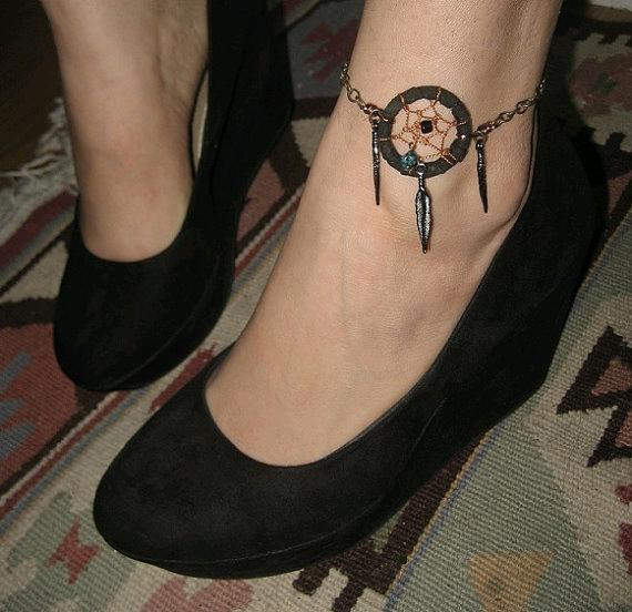 Dreamcatcher tattoo on on foot