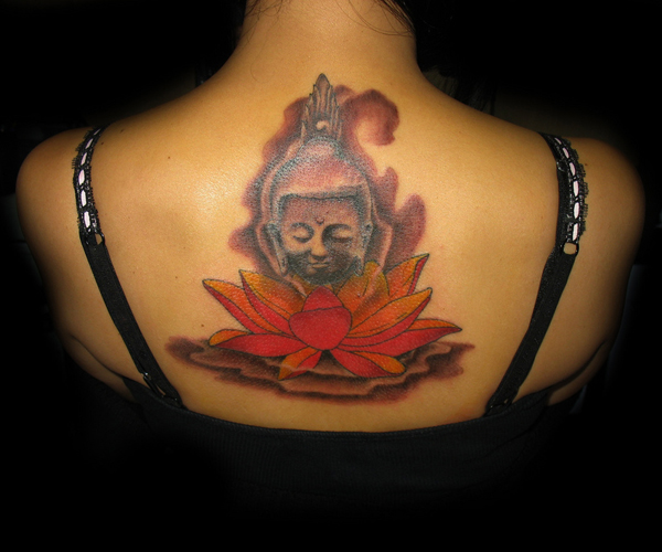 Buddha head with lotus flower