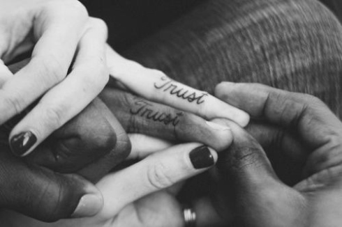 Trust couple tattoo