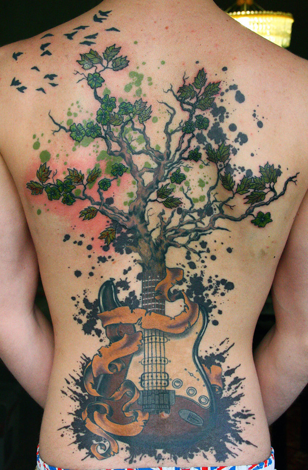 tree tattoo with guitar on back