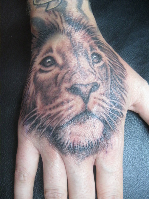 lion tattooon hand