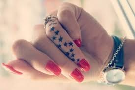 Star tattoo on finger