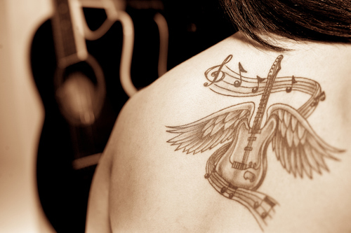 Guitar with feather tatttoo