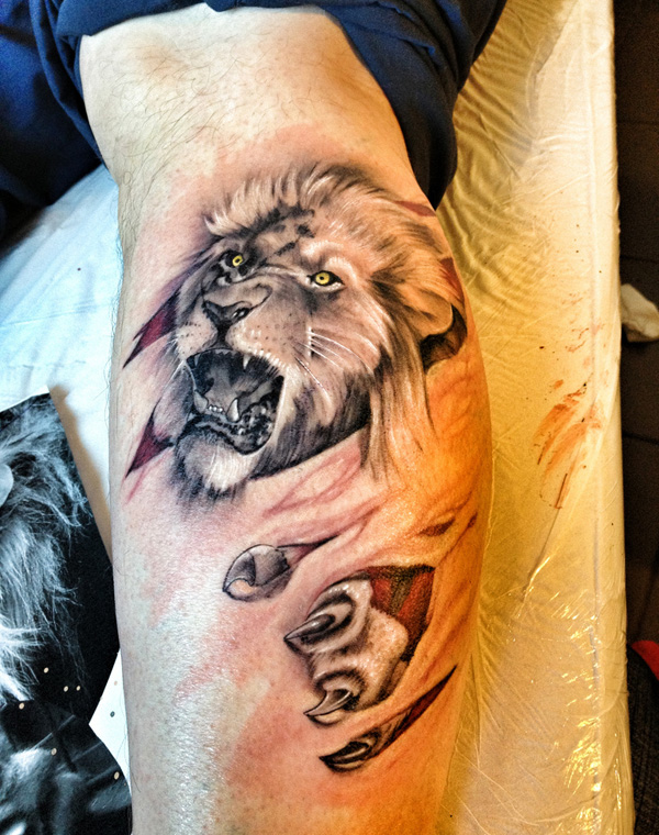 Roaring lion tattoo