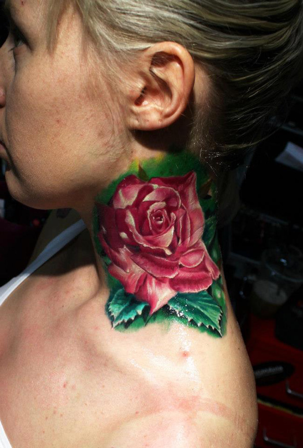 Red rose tattoo on neck