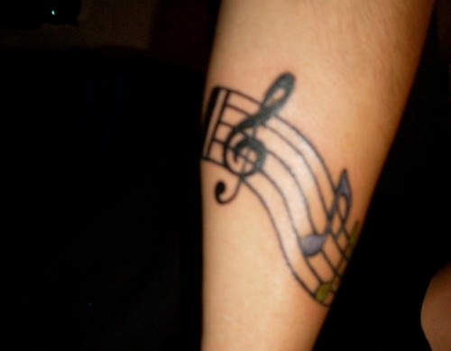 Music notes on hand tattoo