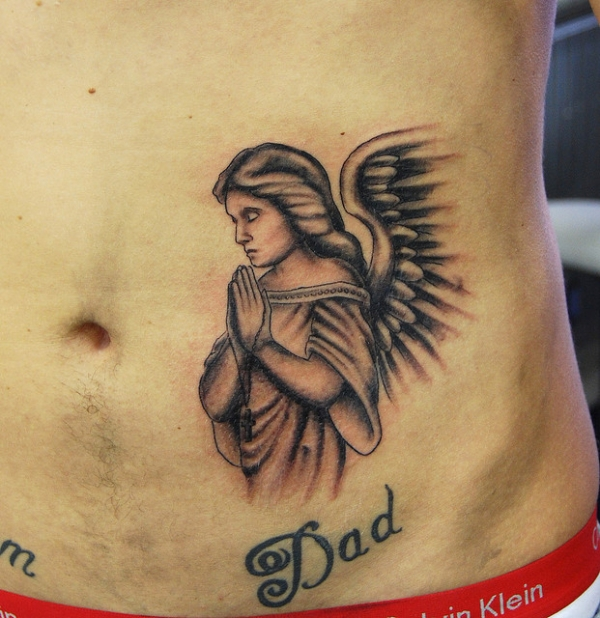 Angel tattoo on rib