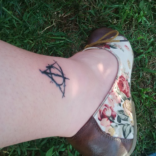 Harry potter tattoo on leg
