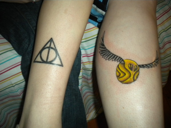 Harry potter tattoo on hand and leg