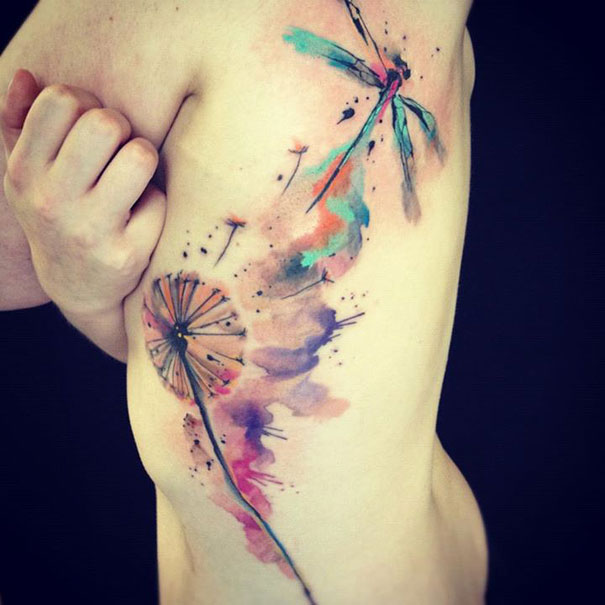 Watercolor tattoo on side