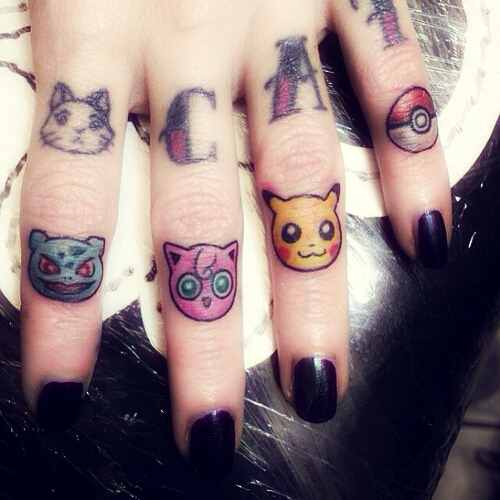 Cats finger tattoo