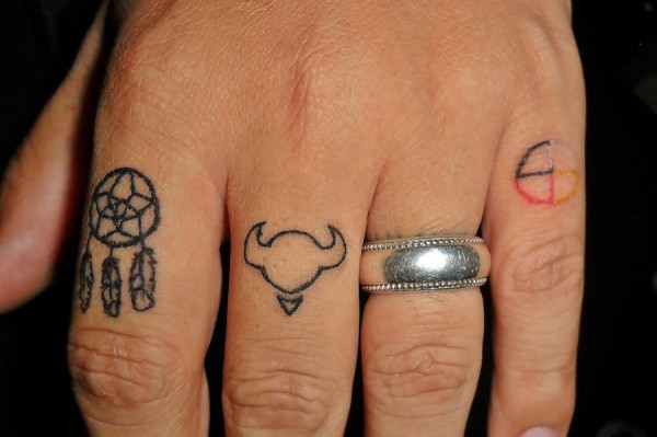 Dream catcher finger tattoo
