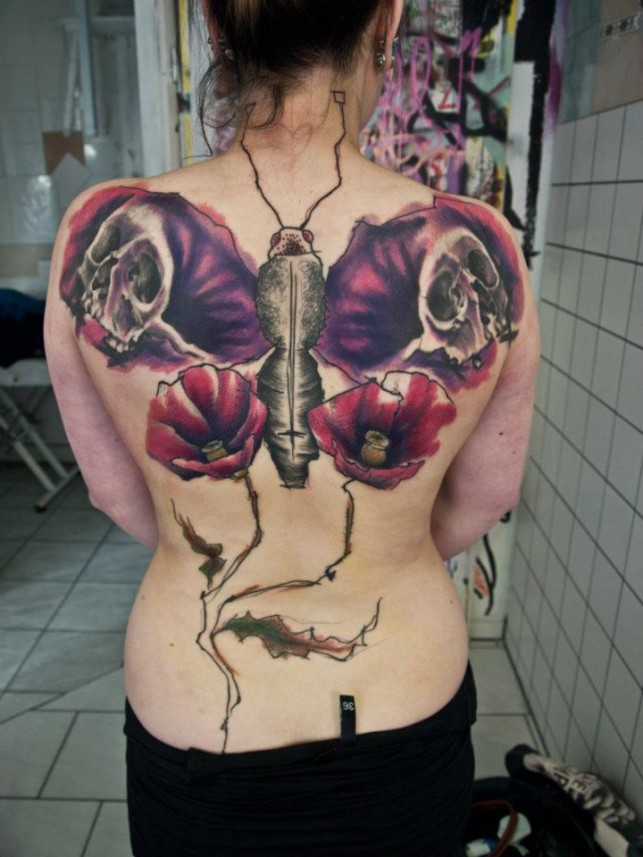 Giant butterfly tattoo on back