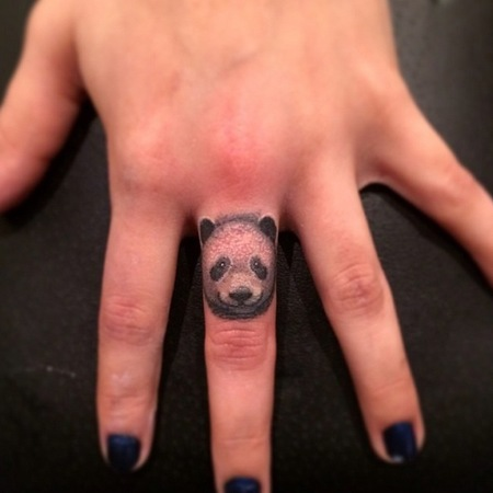 Panda finger tattoo