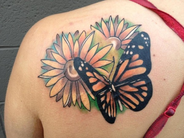 Butterfly tattoo with flower