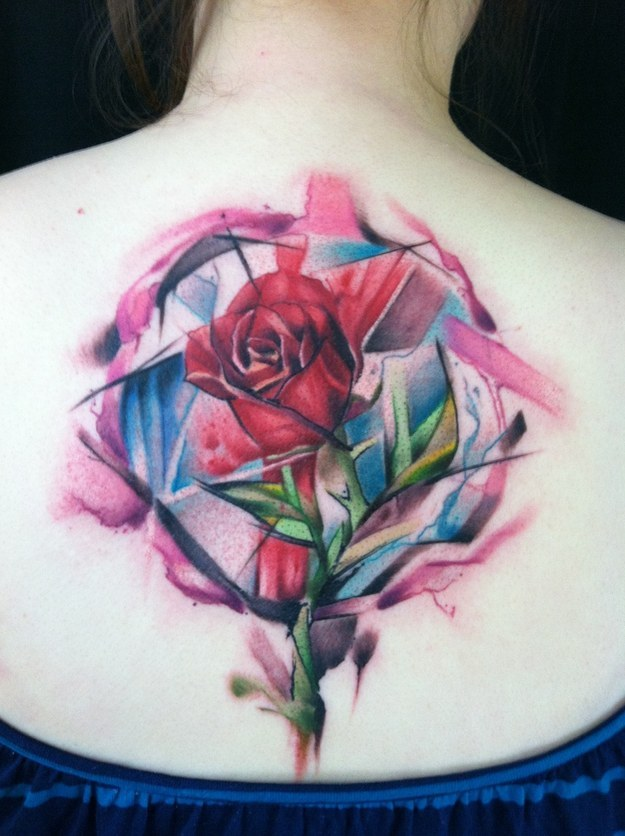 Watercolor rose tattoo on back