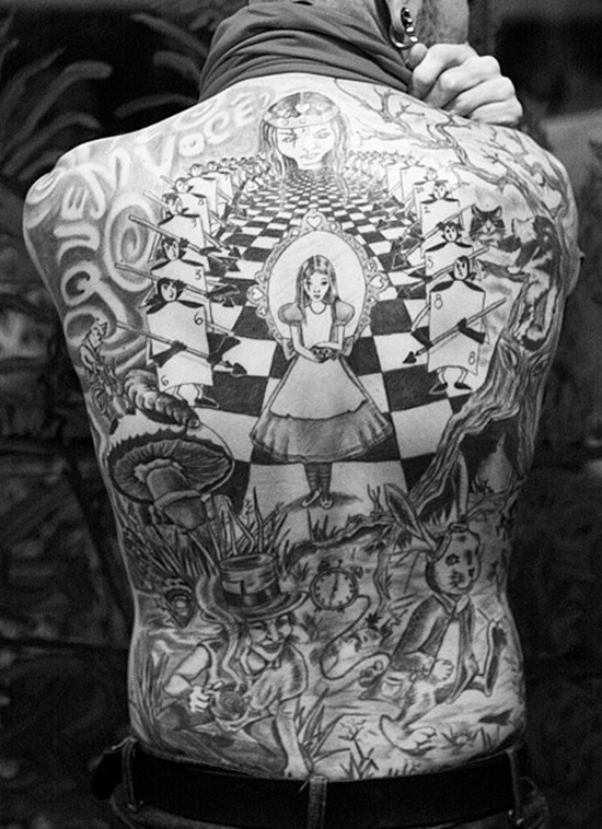 Alice in Wonderland Tattoo on the back