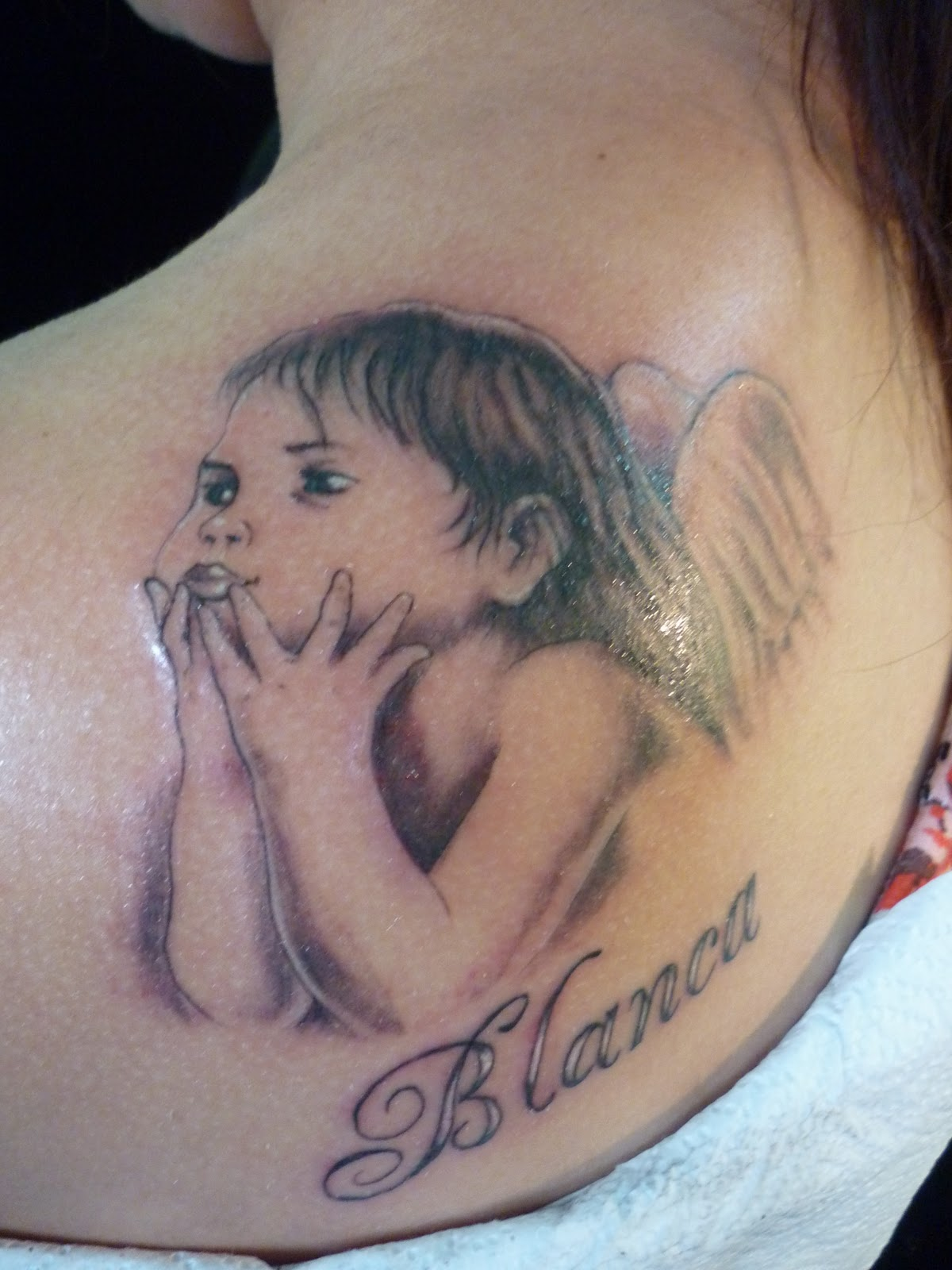Charming Baby Angel Tattoo On Back Shoulder