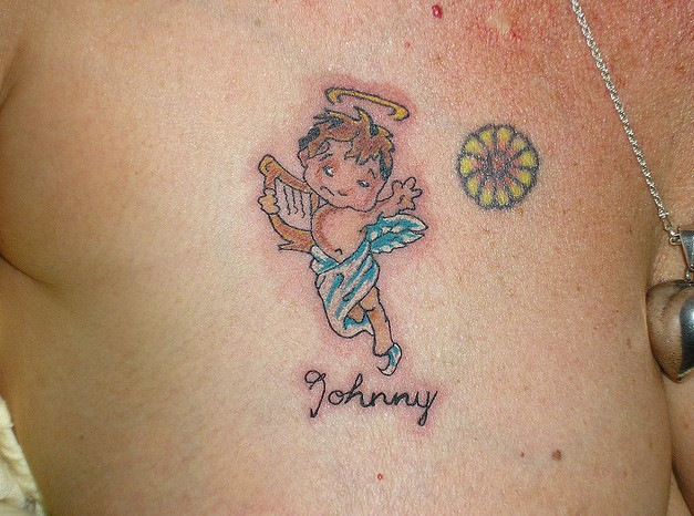 Cute Baby Angel And Name Tattoo On Chest