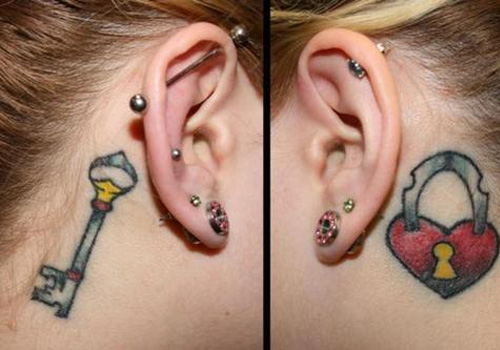 Fancy ear key tattoo