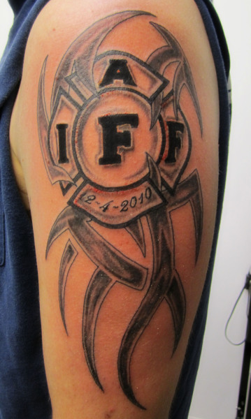 Firefighter Tribal Tattoo on arm