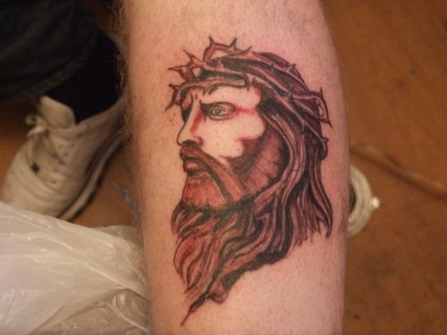 Jesus Christ Face on Leg