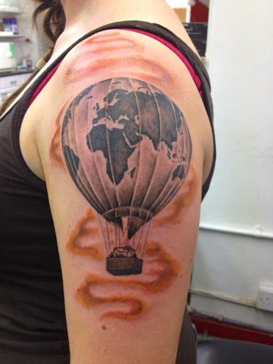 Parachute the air ballon tattoo on upper arm