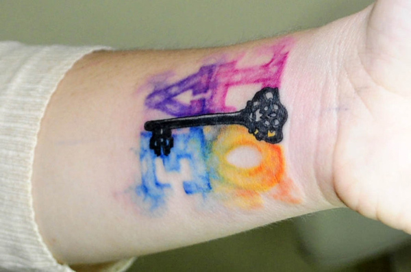 Watercolor love key tattoo