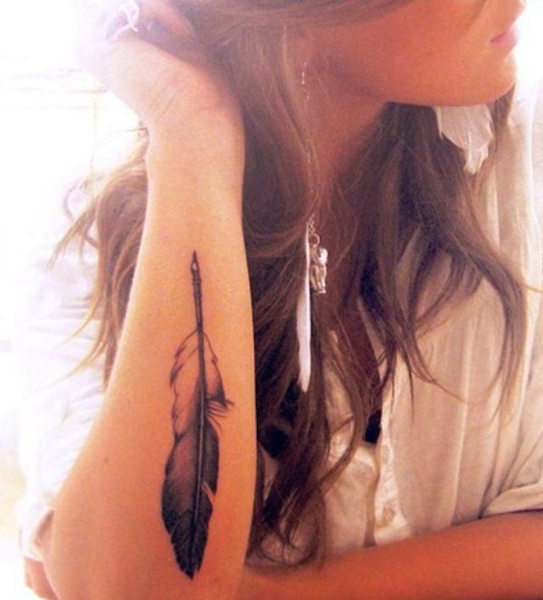 beautiful feather tattoo on arm