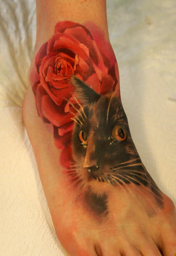 cat and rose tattoo on foot