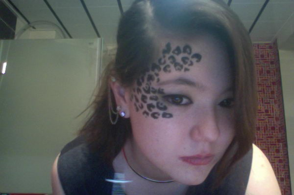 cheetah print tattoo on face