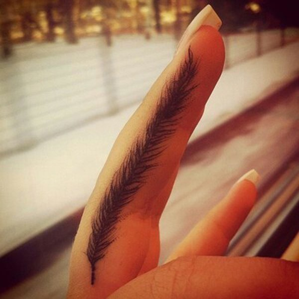 feather tattoo on finger