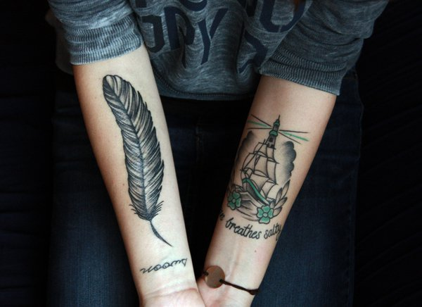 feather tattoo on forearm