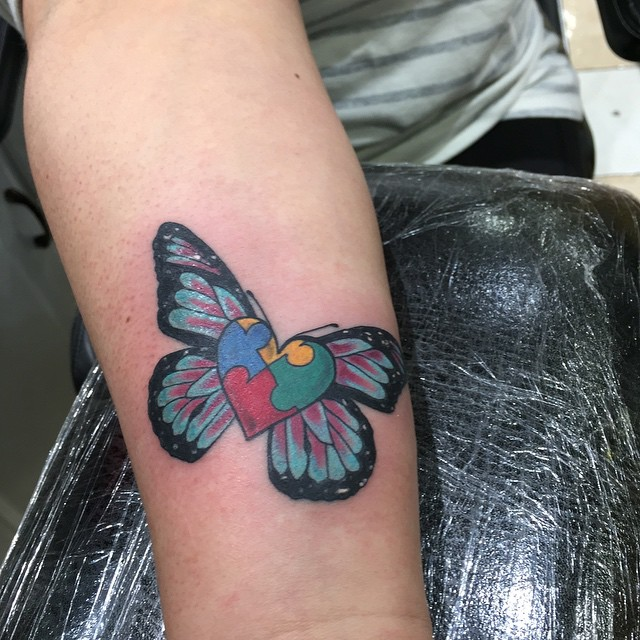 Butterfly Puzzle Piece Tattoo