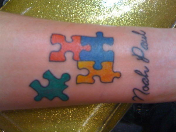 Colorful Autism Puzzle Piece Tattoo