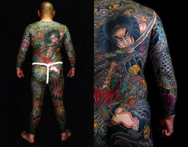 Full back samurai biting a sword tattoo